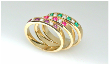 14-karat gold channel-set bands, diamonds and amethysts, rubies, emeralds
