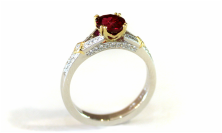 incredible natural red ruby, custom-designed platinum and 18-karat yellow gold ring, double French prongs, beadset diamonds on shoulders and in gallery, bezel-set princess cut diamonds