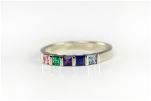 custom-designed mother's ring, princess-cut birthstones, genuine gemstones, bar-set contemporary ring, tourmaline, emerald, amethyst, sapphire, alexandrite