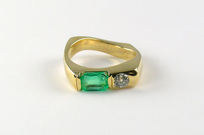 custom-designed 18-karat gold ring, recycled emerald and diamond, twisted square solid shank, flushset diamond