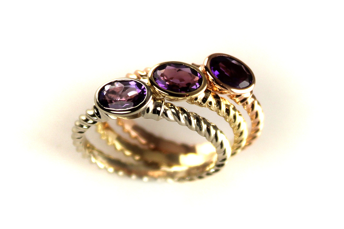 tri-color gold amethyst stack rings, graduated color amethysts, twisted shank, bezel settings