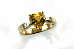 heart-shaped citrine, traditional ring with prongs, flushset diamonds scattered in 14-karat yellow gold ring