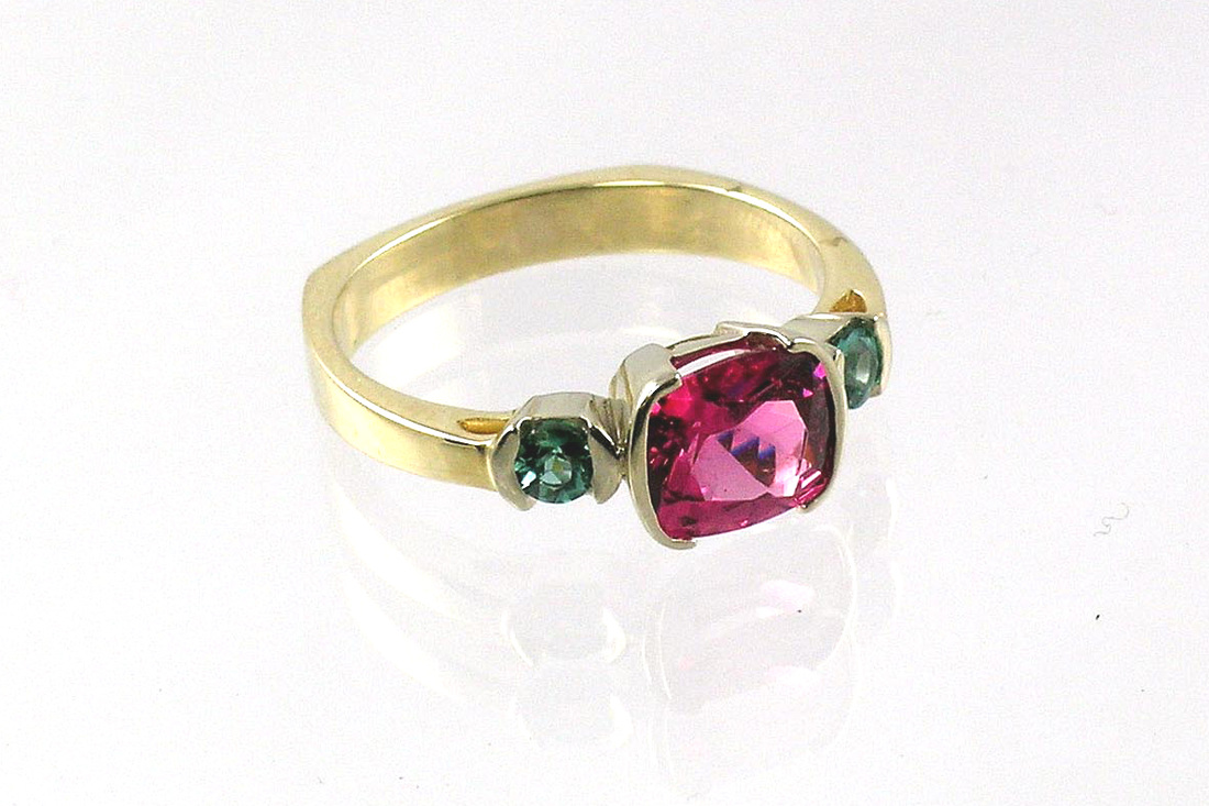 JMD original ring with pink tourmaline and teal tourmaline, bezel set two-tone ring