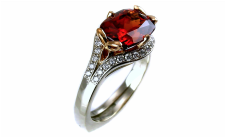 richly saturated spessartite garnet, antique cushion cut, 18-karat custom-alloyed peach gold trefoil accents and prongs, swept beadset diamond split-shank, knife-edge shank, 14-karat white gold
