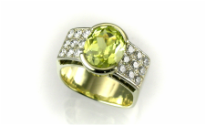 intense yellow chrysoberyl, partial bezel, 18-karat gold, platinum pave plates on shoulders with see-thru to culet, square shaped ring
