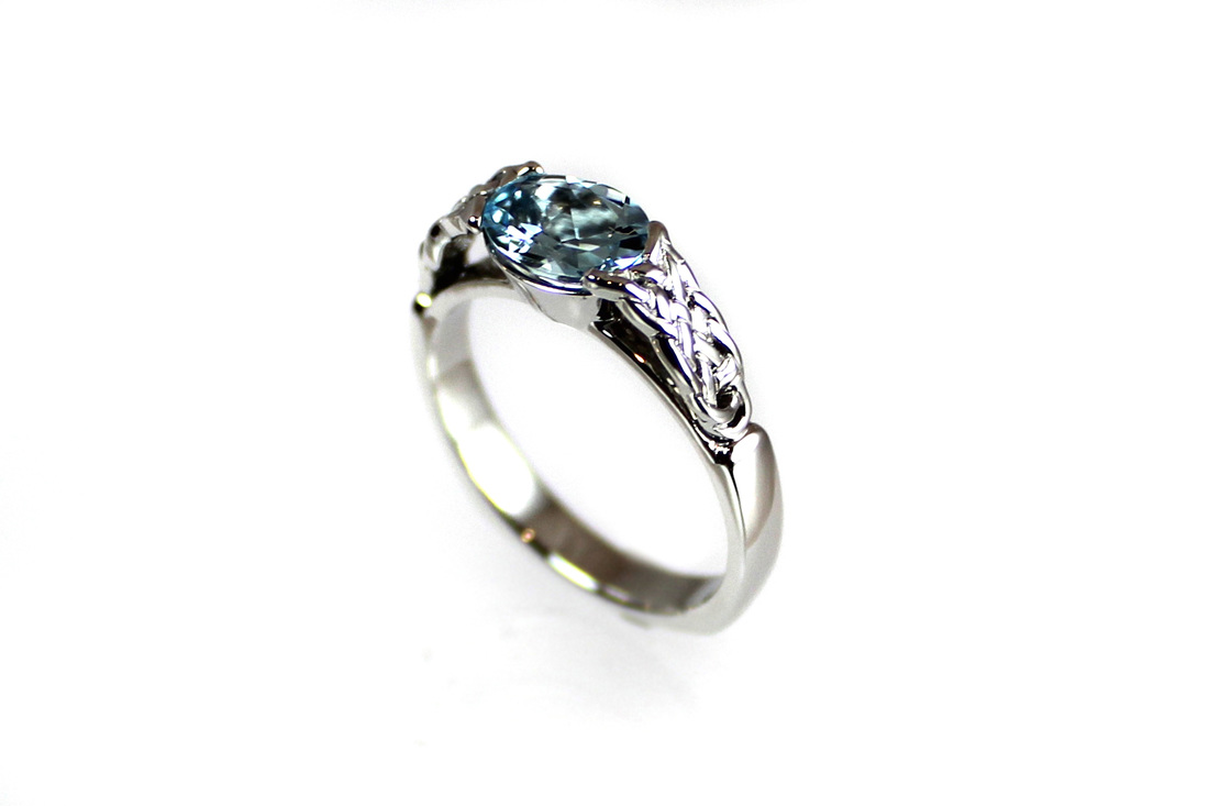 oval aquamarine, partial bezel setting, 14-karat white gold, Celtic knotwork ring