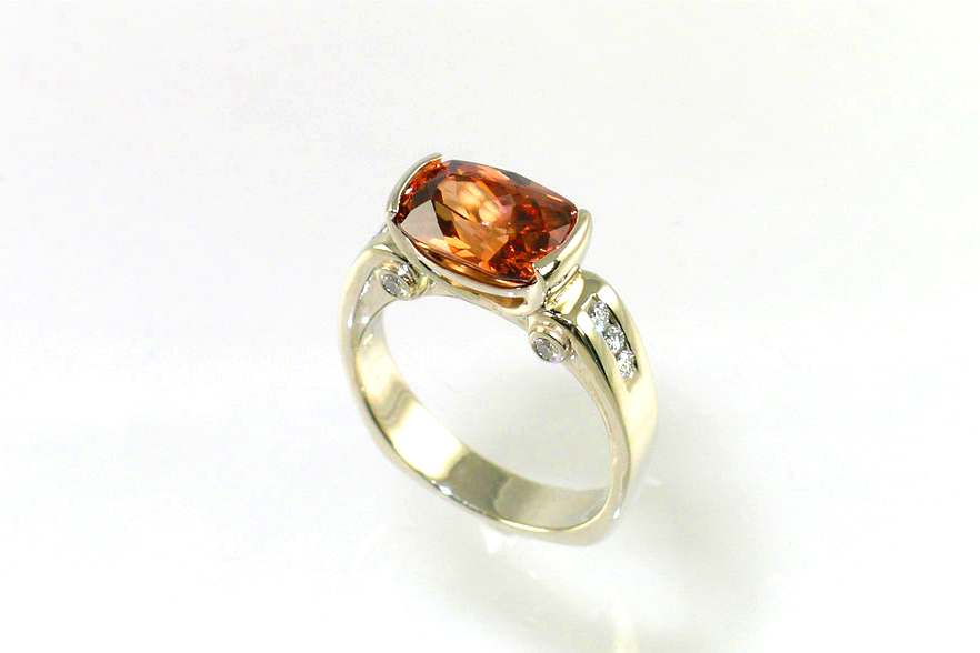 rootbeer tourmaline, antique cushion cut, custom-designed ring, 14-karat white gold partial bezel, unique scrollwork gallery, channel set diamonds on shoulders