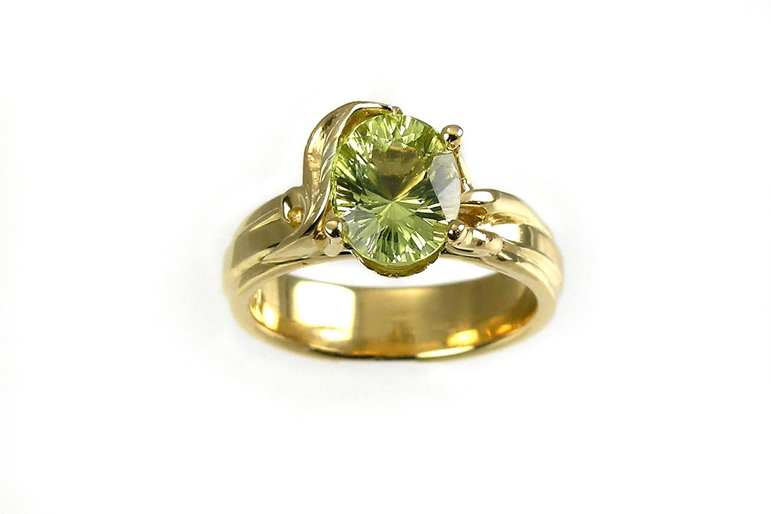 fantasy-cut chrysoberyl, custom-designed ring with leaf and prongs, 18-karat yellow gold