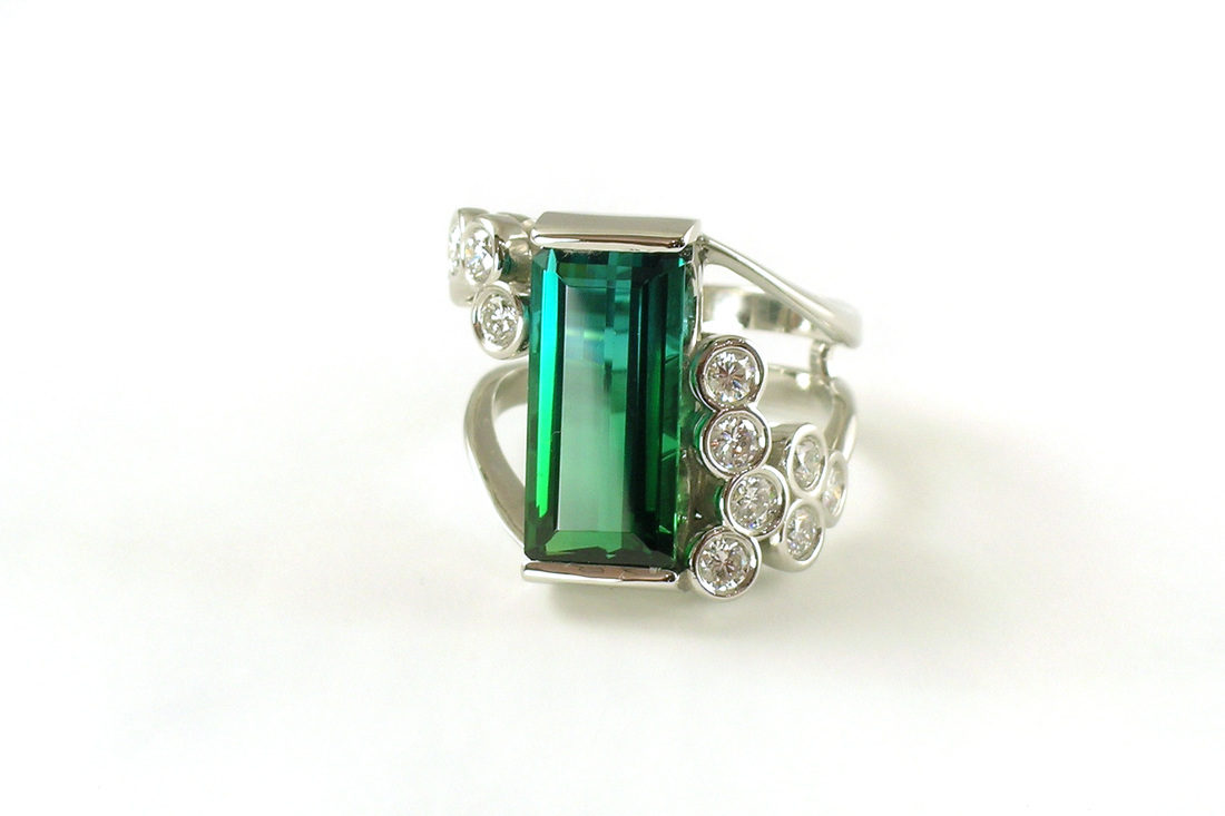 rare bi-color tourmaline, custom bar-end setting, split-shank ring, bezel-set diamond bubbles