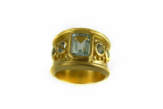 22-karat yellow gold, custom-designed Byzantine ring, emerald-cut blue topaz, bezel setting, granulation, sand-blasted finish