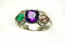 custom-designed mother's ring with cushion-cut amethyst, topaz and emerald pear-shaped gemstones, hearts and milgrain filigree details, weighted shank