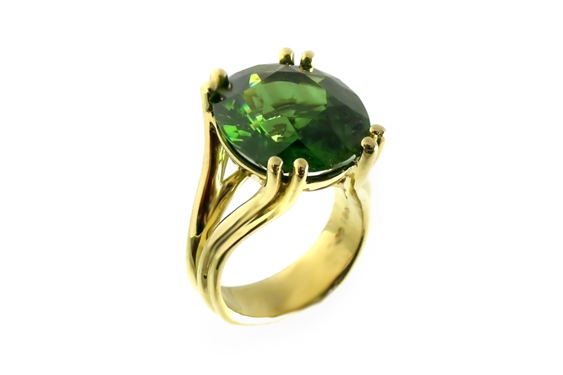 rare 8+ carat green zircon, custom-designed 18-karat yellow gold split shank ring, double French prongs, weighted shank