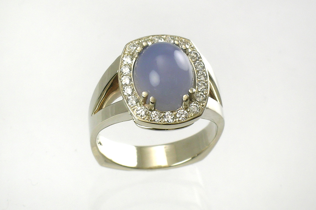 mystical blue chalcedony cabochon, custom-designed split-shank ring, 14-karat white gold, double French prongs, beadset diamond halo, weighted Euro shank