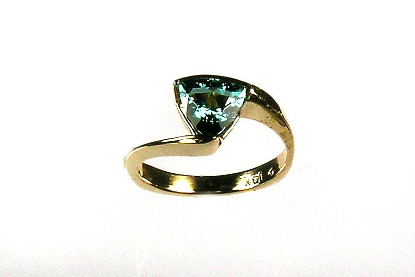 teal tourmaline in custom-designed bypass style ring, 14-karat gold, no prongs