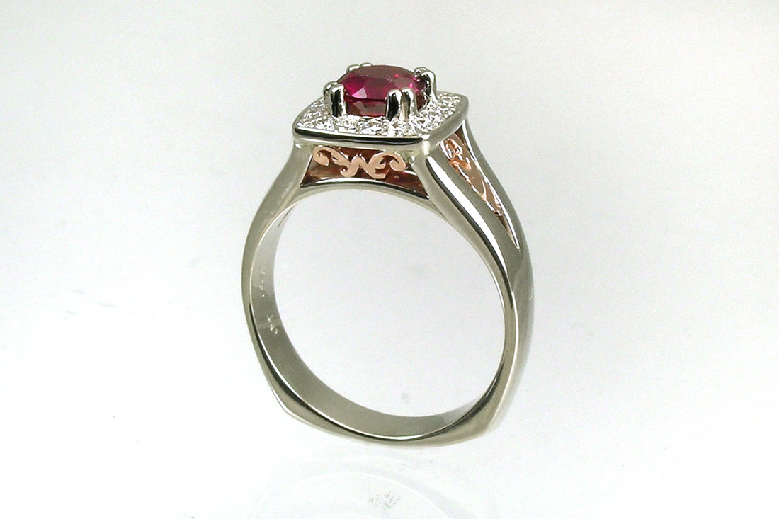 custom-designed setting for repurposed heirloom spinel, beadset diamond halo, rosegold filigree initial and scrollwork details, 14-karat white gold ring, square weighted Euro shank, two-tone gold setting