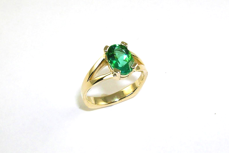 custom-designed split-shank ring, 18-karat yellow gold, bright green tourmaline, prongs