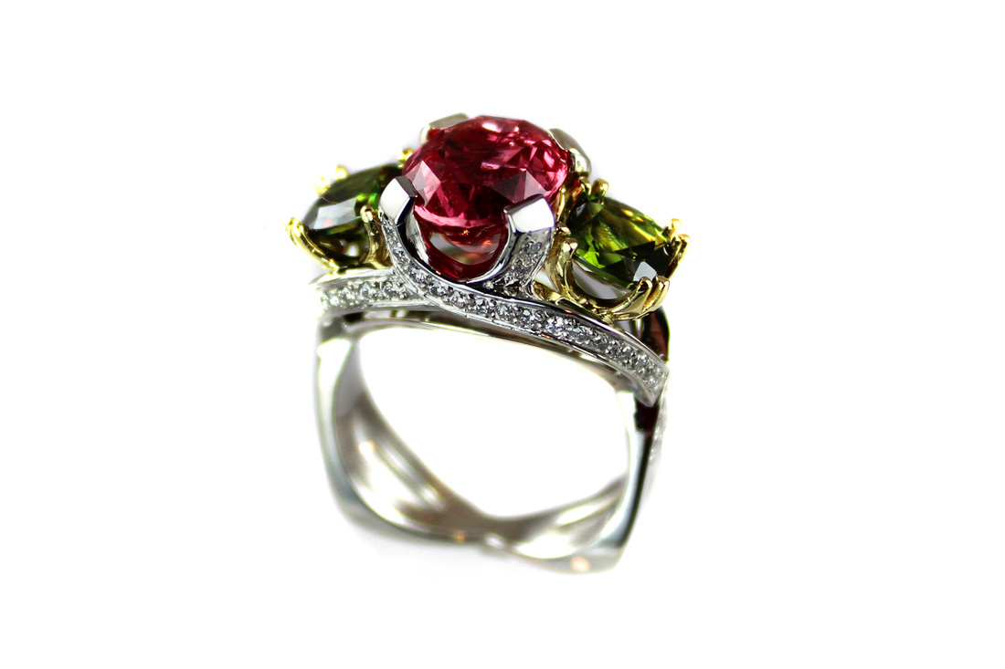 custom-designed competition ring, platinum and 18-karat yellow gold, padparadscha sapphire and sphene, beadset diamonds on shoulders and through-finger gallery, split to criss-cross square shank