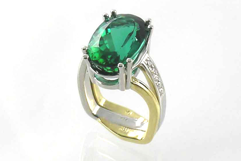 8+ carat blue-green tourmaline oval, two-tone platinum and 18-karat yellow gold ring, beadset diamonds on shoulders, double French prongs