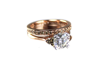 Custom rose gold engagement ring and eternity band with champagne diamonds